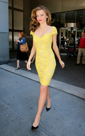 Miranda Kerr dazzles in a lacey yellow dress when out and about in NYC